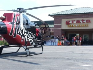 Husker chopper lands in Clocktower's parking lot for signing event.